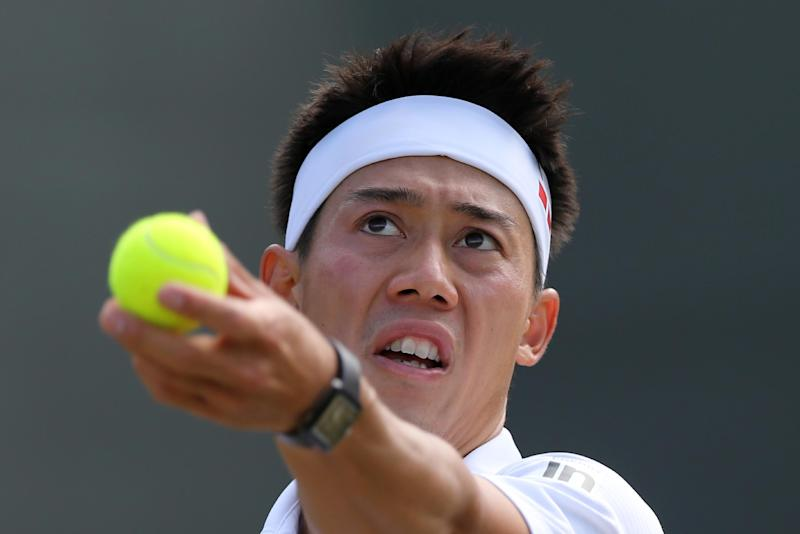 Japan's Kei Nishikori serves during his men's singles fourth round match against Canada's Milos Raonic on day eight of the 2014 Wimbledon Championships in Wimbledon, southwest London, on July 1, 2014
