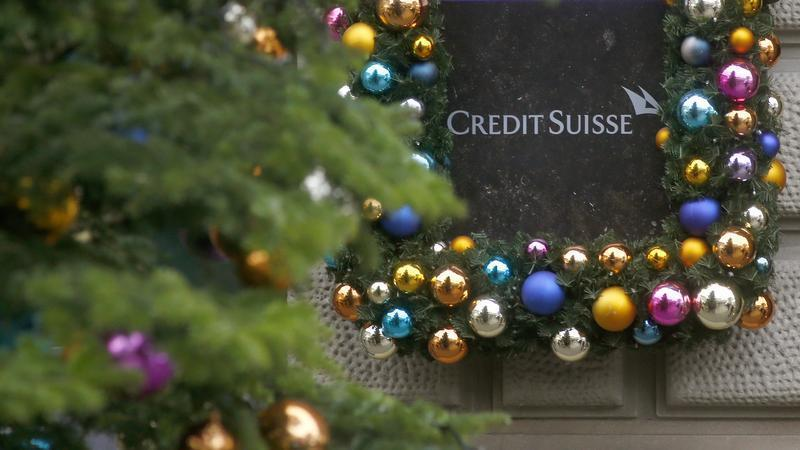 Christmas decoration is placed around the logo of Swiss bank Credit Suisse in Zurich