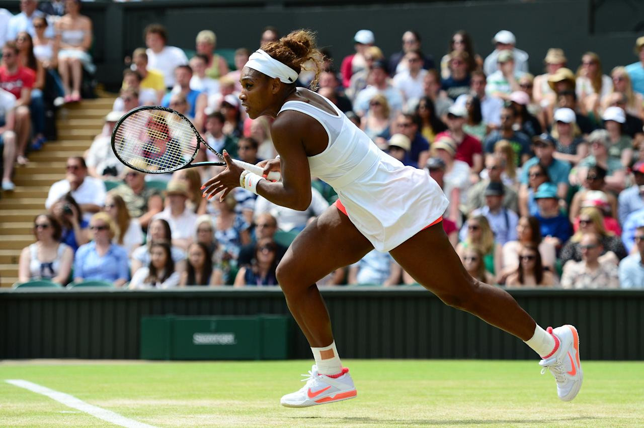 LONDON, ENGLAND - JULY 01: Serena Williams of United States of America in action during her Ladies' Singles fourth round match against Sabine Lisicki of Germany on day seven of the Wimbledon Lawn Tennis Championships at the All England Lawn Tennis and Croquet Club on July 1, 2013 in London, England. (Photo by Mike Hewitt/Getty Images)