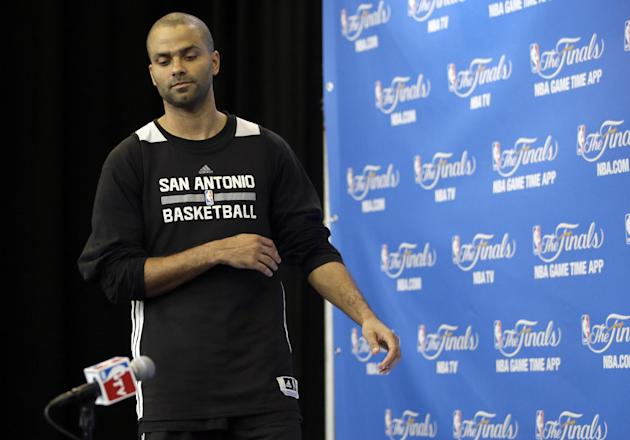 San Antonio Spurs guard Tony Parker arrives for a press conference during practice on Friday, June 6, 2014, in San Antonio. The team plays Game 2 of the NBA Finals against the Miami Heat on Sunday. (AP Photo/Tony Gutierrez)