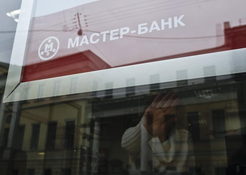 The company logo of Master Bank is seen outside a branch in Moscow