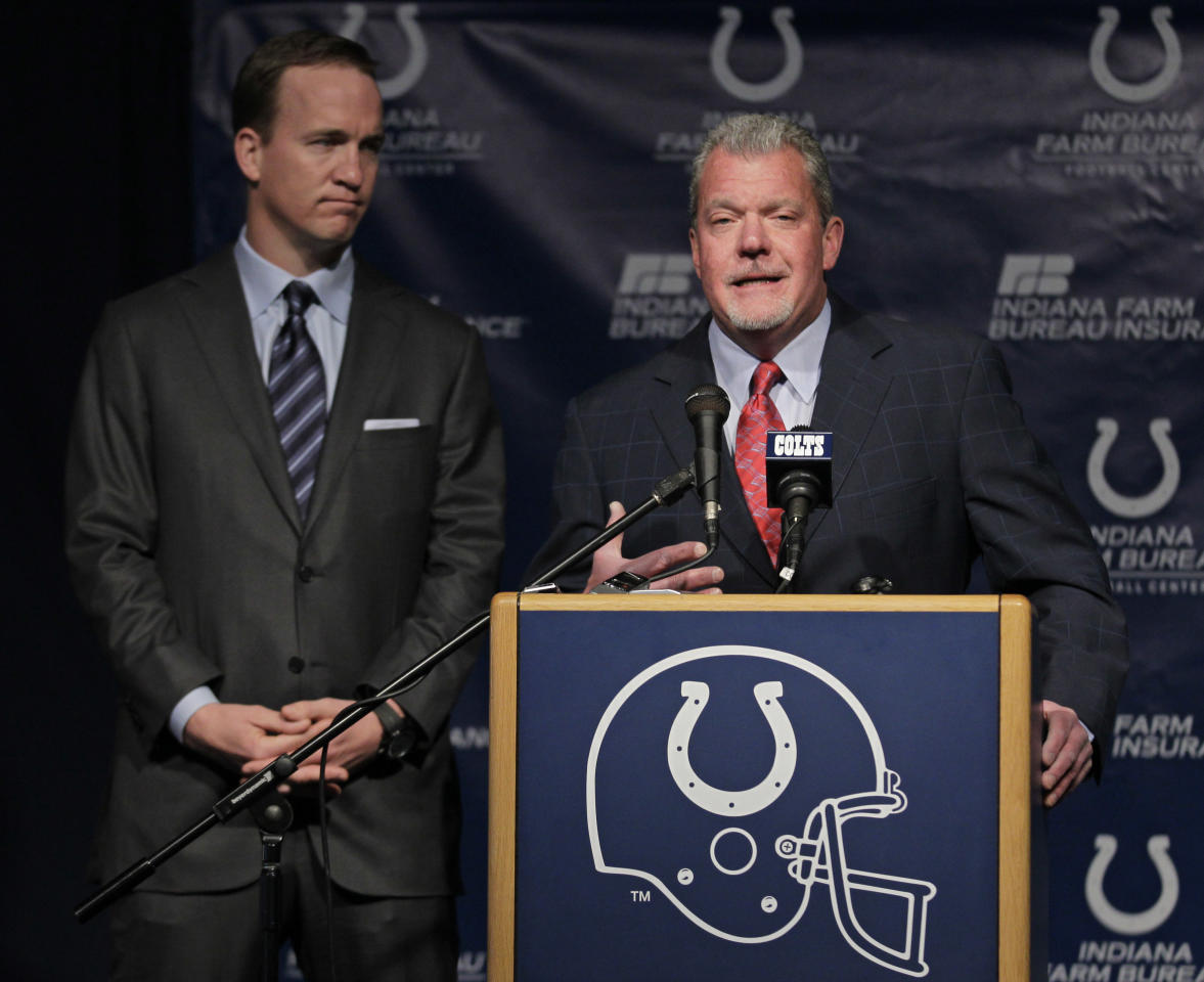 Indianapolis Colts owner Jim Irsay, right, announces that the NFL football team will release quarterback Peyton Manning, left,  during a news conference in Indianapolis, Wednesday, March 7, 2012. (AP Photo/Michael Conroy)