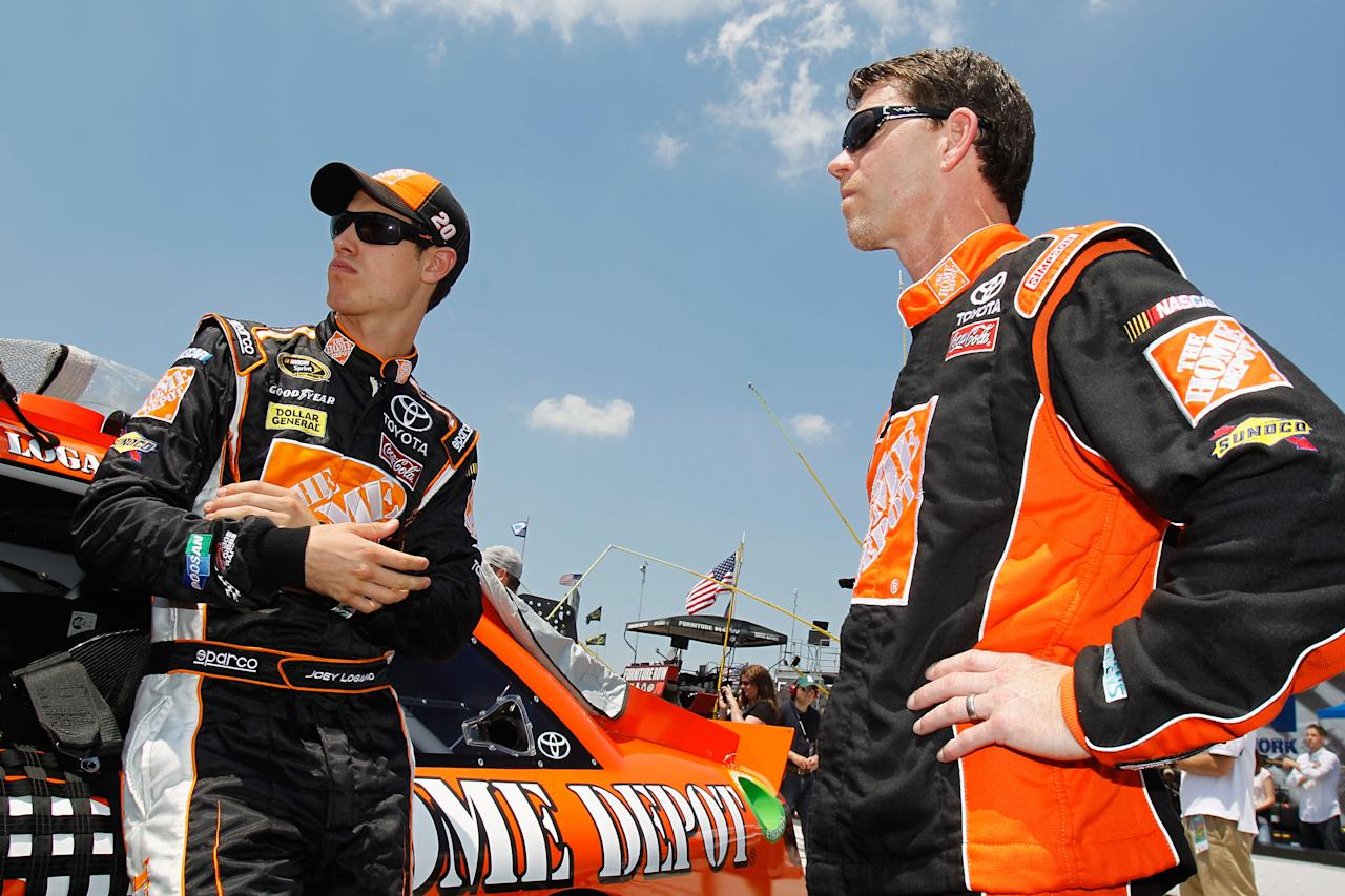 LONG POND, PA - JUNE 10:  Joey Logano (L), driver of the #20 The Home Depot Toyota, stands with crew cheif Jason Ratcliff on the grid before the start of the NASCAR Sprint Cup Series Pocono 400 presented by #NASCAR at Pocono Raceway on June 10, 2012 in Long Pond, Pennsylvania.  (Photo by Todd Warshaw/Getty Images for NASCAR)