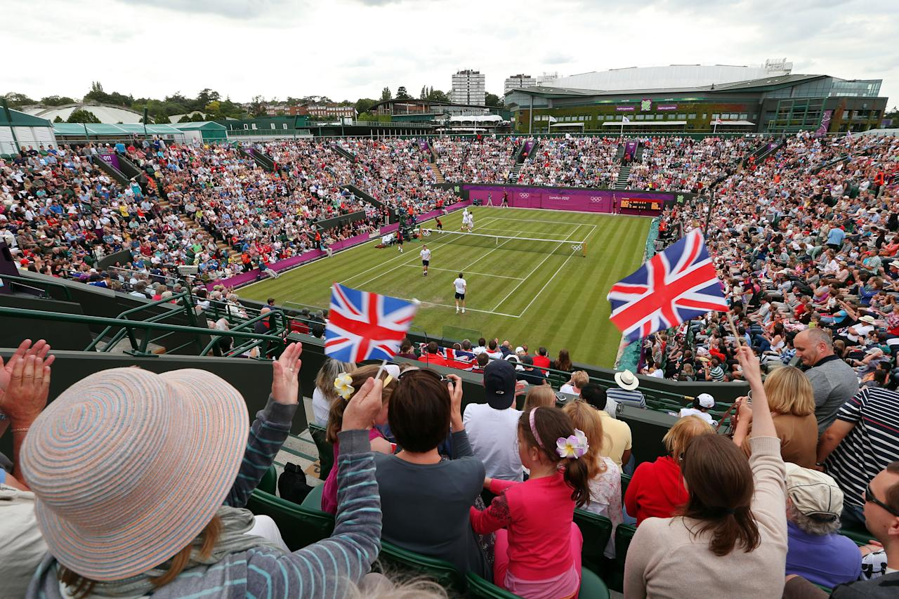 LONDON, ENGLAND - JULY 28:  Fans cheer as Andy Murray and Jamie Murray of Great Britain play against Alexander Peya and Jurgen Melzer of Austria during their Men's Doubles Tennis match on Day 1 of the London 2012 Olympic Games at the All England Lawn Tennis and Croquet Club in Wimbledon on July 28, 2012 in London, England.  (Photo by Clive Brunskill/Getty Images)