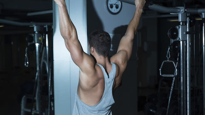 3 Challenging Workouts You Can Do With a Pull-Up Bar