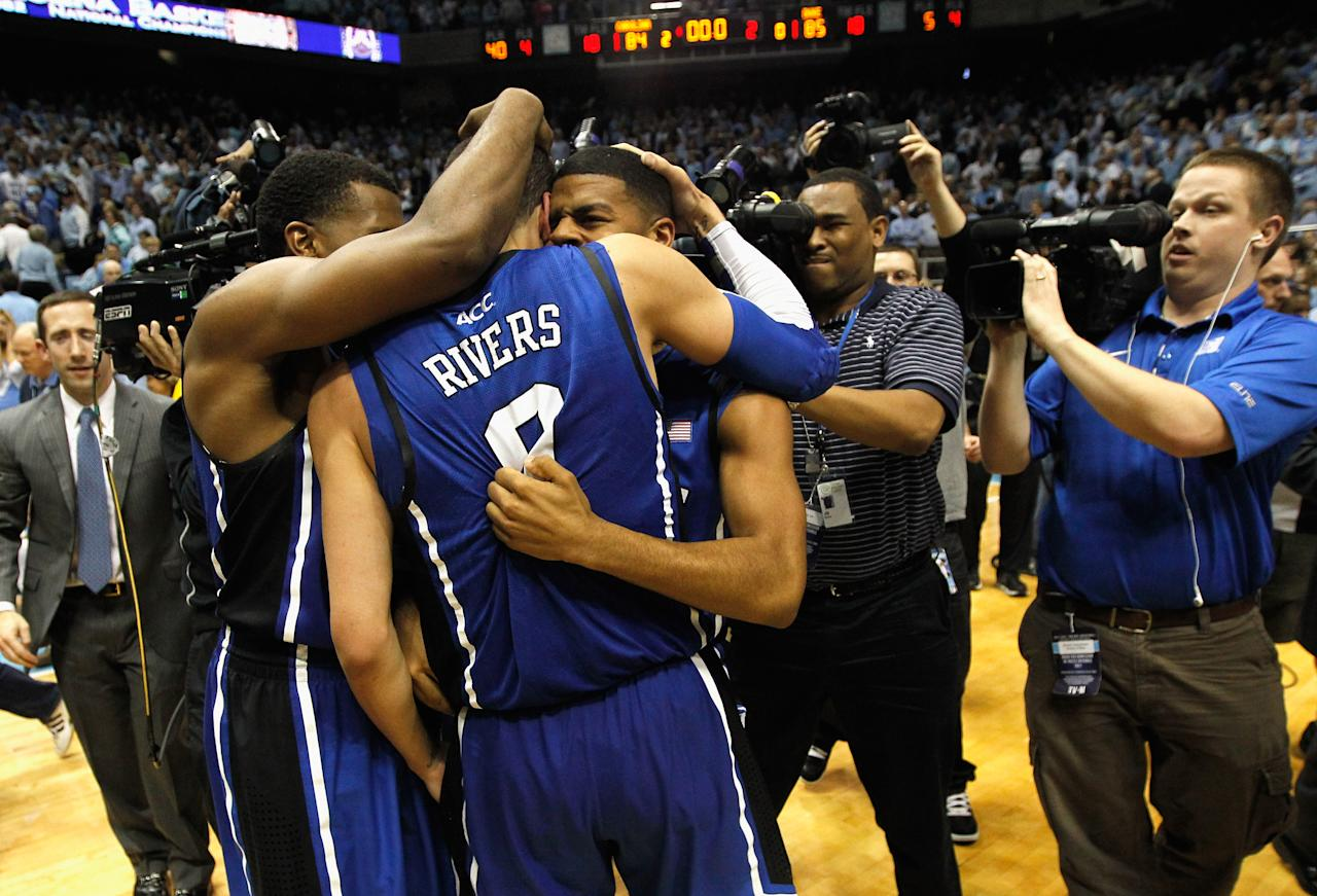 CHAPEL HILL, NC - FEBRUARY 08:  Austin Rivers #0 of the Duke Blue Devils celebrates with teammates after hitting a game-winning 3 pointer to defeat the North Carolina Tar Heels 85-84 during their game at the Dean Smith Center on February 8, 2012 in Chapel Hill, North Carolina.  (Photo by Streeter Lecka/Getty Images)