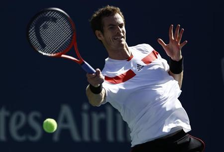 Murray of Britain hits a return to Wawrinka of Switzerland at the U.S. Open tennis championships in New York