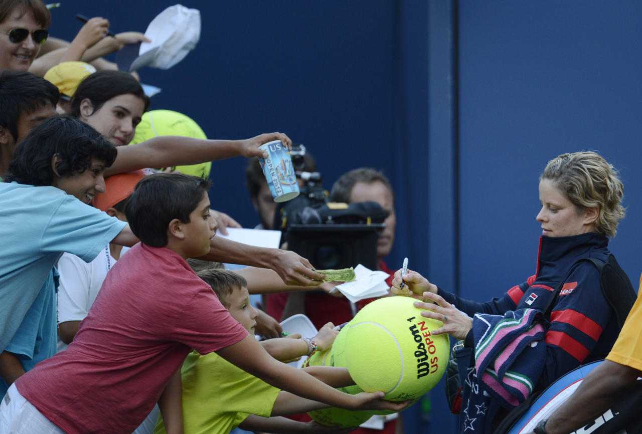 Aug 29, 2012; Queens, NY, USA; Kim Clijsters (BEL), right, signs autographs for fans after her match against Laura Robson (GBR) on day three of the 2012 US Open at Billie Jean King National Tennis Center.   Robson won 7-6, 7-6. Mandatory Credit: Jerry Lai-USA TODAY Sports