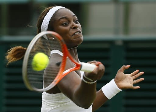 Sloane Stephens of the United States returns to Monica Puig of Puerto Rico during their Women's singles match at the All England Lawn Tennis Championships in Wimbledon, London, Monday, July 1, 2013. (AP Photo/Kirsty Wigglesworth)