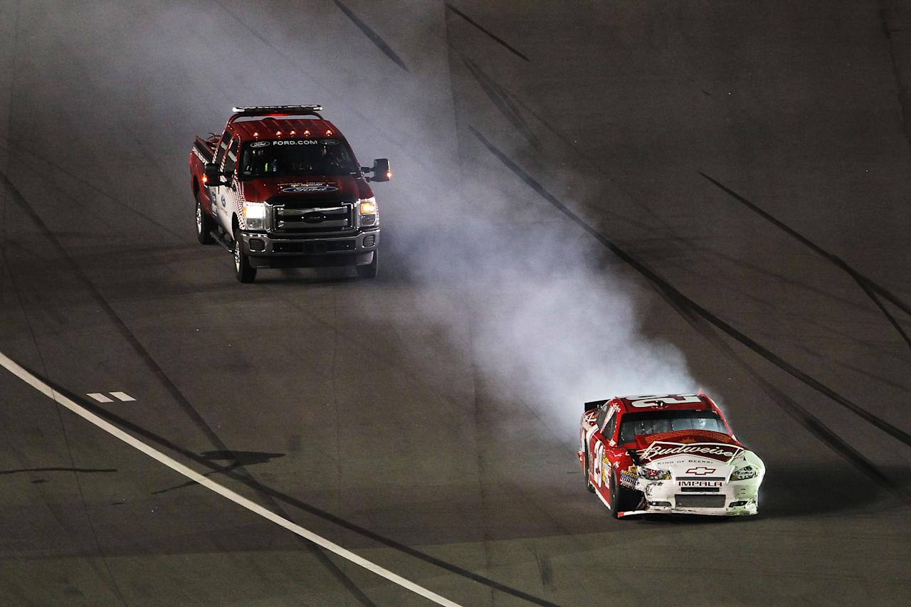 DAYTONA BEACH, FL - FEBRUARY 18:  Kevin Harvick, driver of the #29 Budweiser Chevrolet, drives on the apron after a crash during the NASCAR Budweiser Shootout at Daytona International Speedway on February 18, 2012 in Daytona Beach, Florida.  (Photo by Jamie Squire/Getty Images)