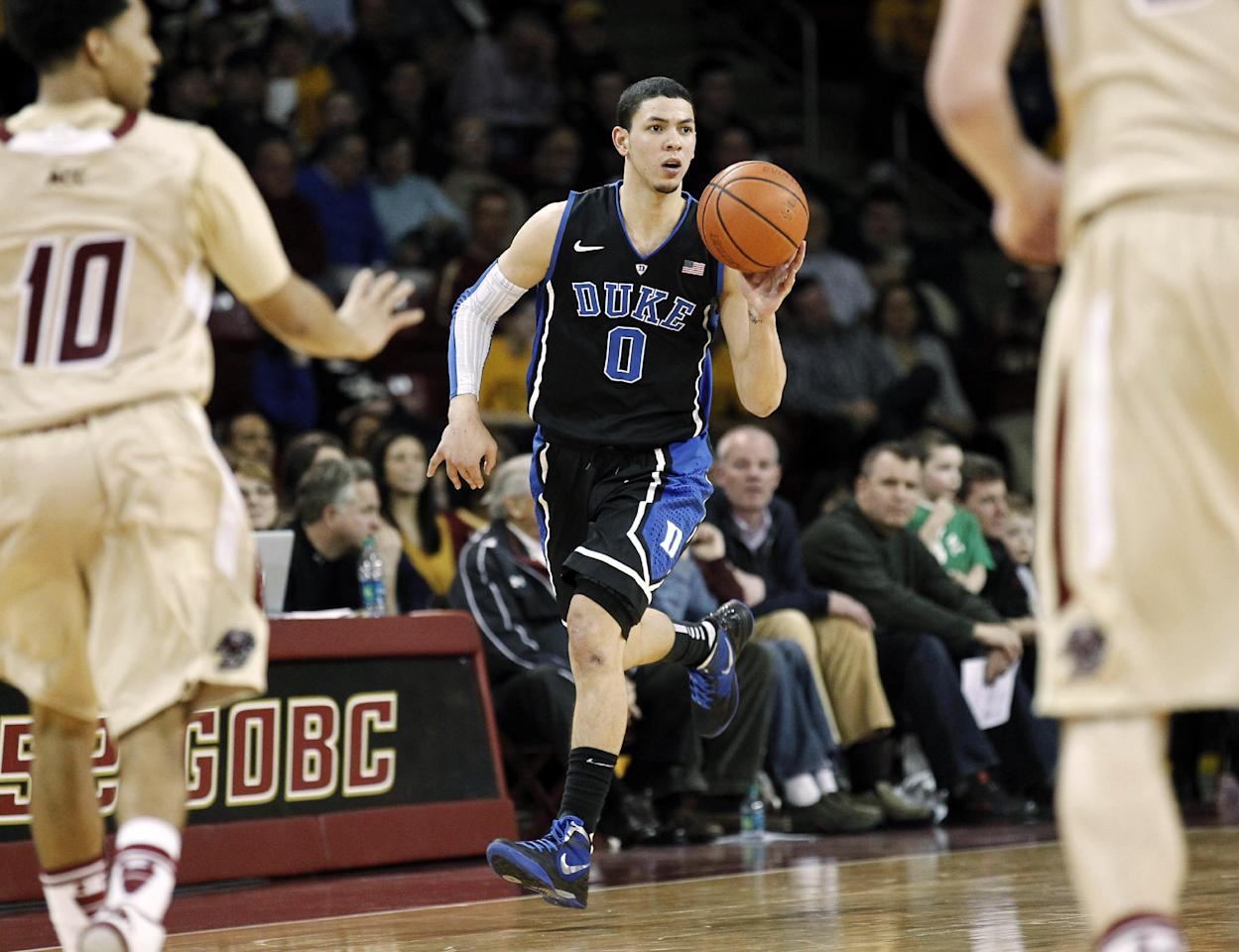 Duke's Austin Rivers brings the ball upcourt during the second half of their 75-50 win over Boston College in an NCAA college basketball game in Boston, Sunday, Feb. 19, 2012. (AP Photo/Winslow Townson)