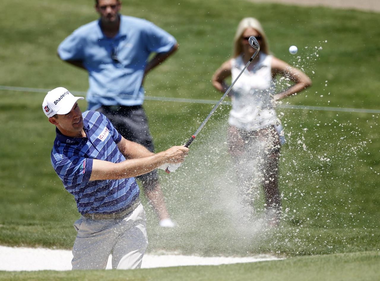 Padraig Harrington, of Ireland, hits out of a bunker to the first green during the opening round of the PGA Byron Nelson Championship golf tournament, Thursday, May 17, 2012, in Irving, Texas. (AP Photo/Tony Gutierrez)