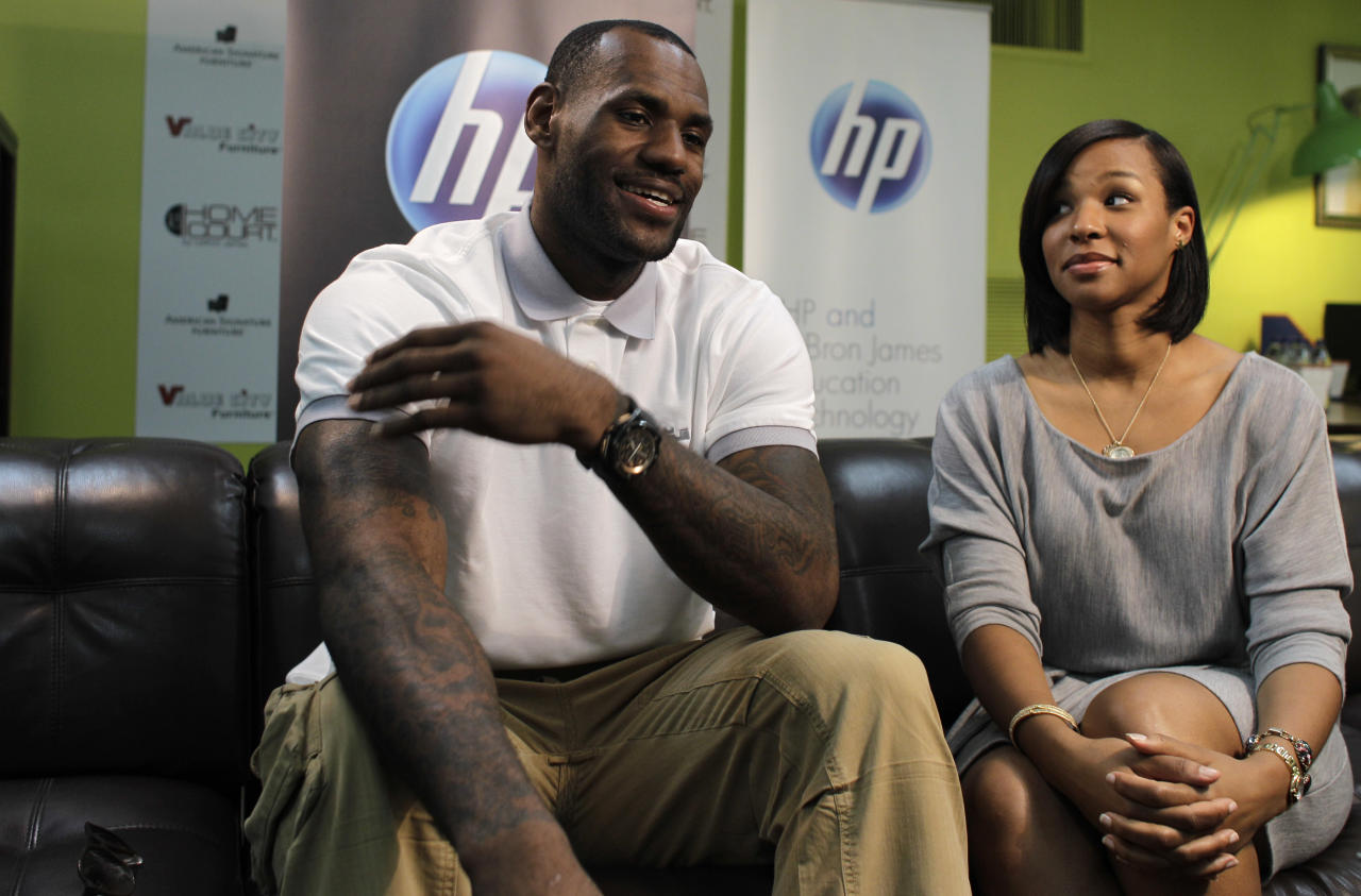Miami Heat basketball player LeBron James, left, sits with his girlfriend Savannah Brinson during an interview with The Associated Press prior to a charity event at the Northwest Boys & Girls Club in Miami, Wednesday, March 2, 2011. The LeBron James Family Foundation partnered with HP to donate 1,000 computers nationwide to Boys & Girls Clubs of America.
