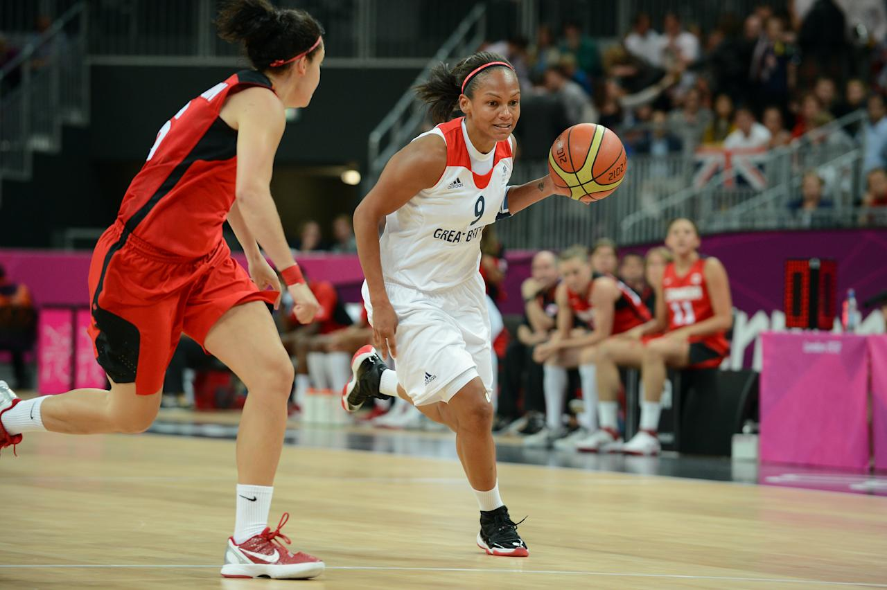LONDON, ENGLAND - JULY 30: Jenaya Wade-Fray #9 of Great Britain dribbles versus Canada at the Olympic Park Basketball Arena during the London Olympic Games on July 30, 2012 in London, England. NOTE TO USER: User expressly acknowledges and agrees that, by downloading and/or using this Photograph, user is consenting to the terms and conditions of the Getty Images License Agreement. Mandatory Copyright Notice: Copyright 2012 NBAE (Photo by Garrett W. Ellwood/NBAE via Getty Images)