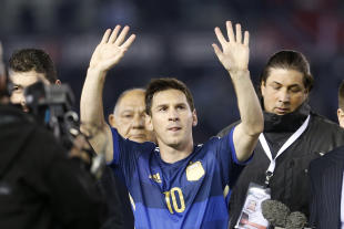 Lionel Messi waves to fans at the end of an international friendly against Trinidad and Tobago on June 4. (AP)