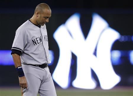 Yankees Derek Jeter reacts after the end of the first inning against the Blue Jays induring their MLB baseball game in Toronto