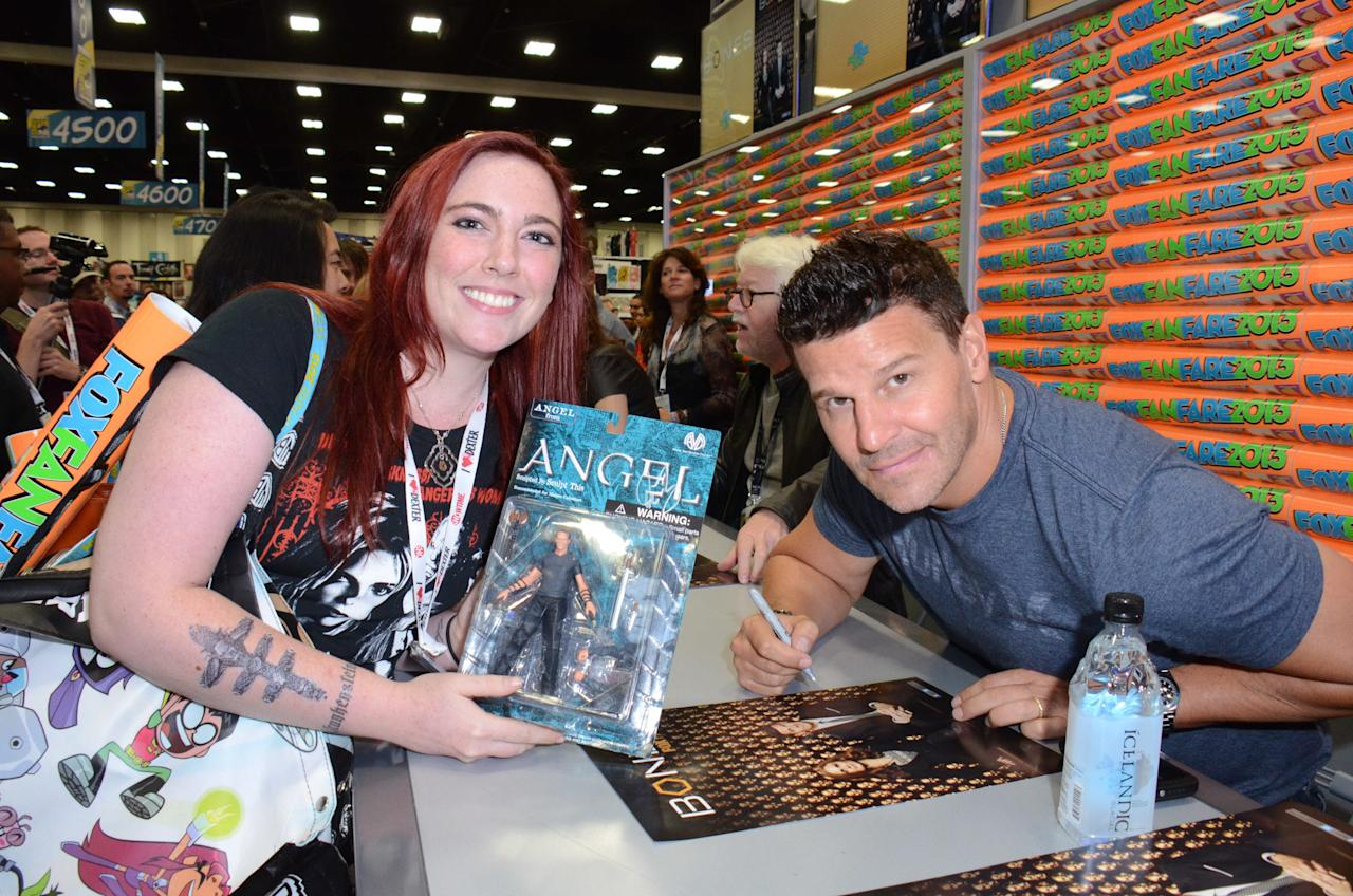 """Bones"" cast member David Boreanaz greets and signs an exclusive limited edition ""Bones"" poster for fans on Friday, July 19 during Fox Fanfare at San Diego Comic-Con 2013."