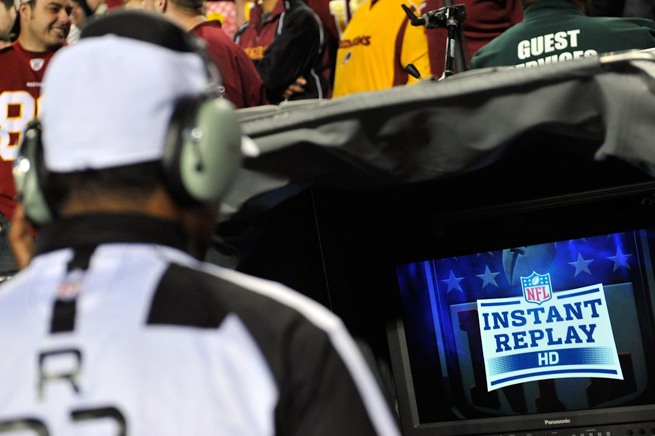 LANDOVER, MD - DECEMBER 03:  Referee Jerome Boger #23 looks into the replay booth on a challenge call in the first quarter in the game between the Washington Redskins and the New York Giants at FedExField on December 3, 2012 in Landover, Maryland.  (Photo by Patrick McDermott/Getty Images)