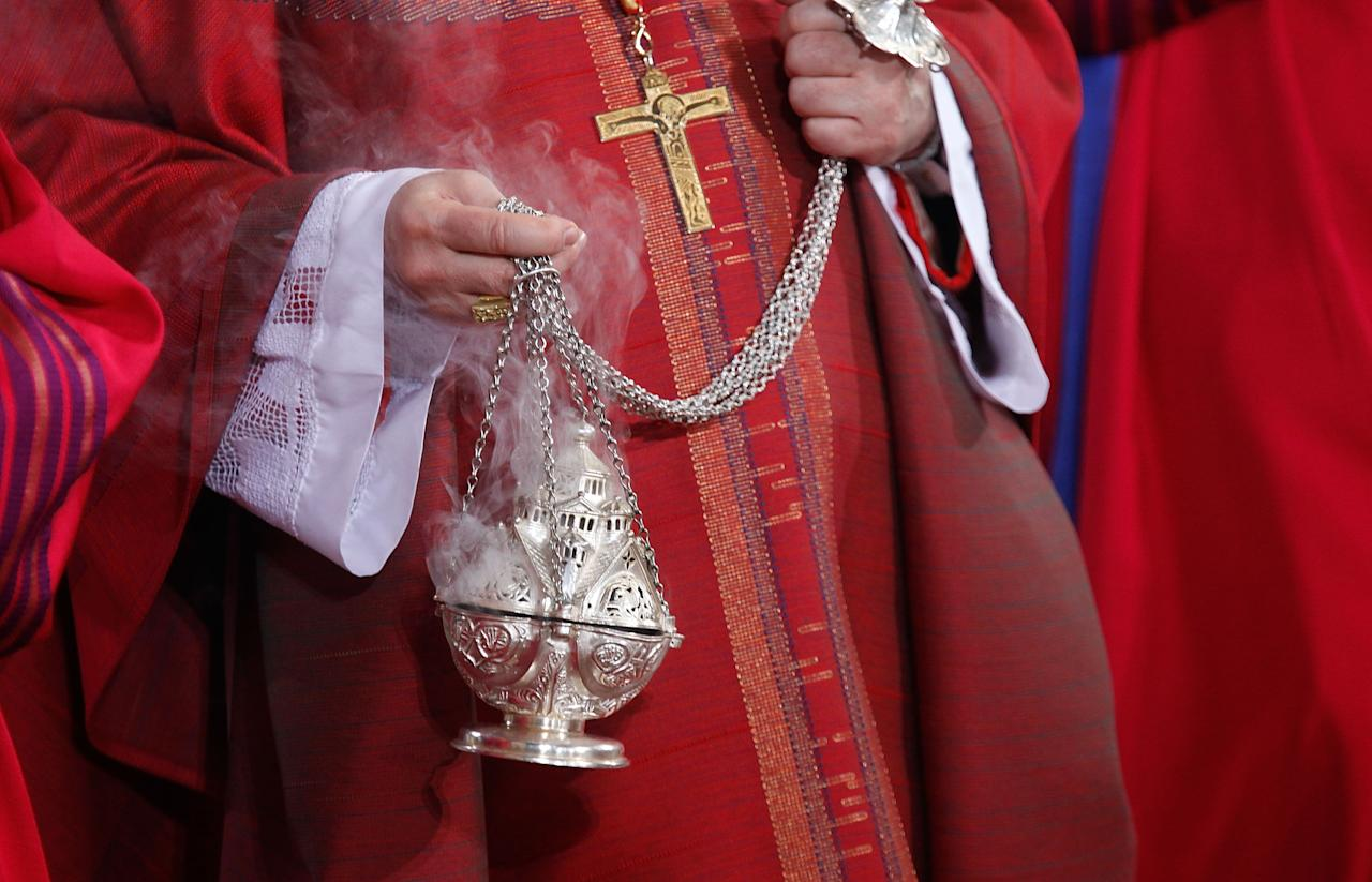 TRIER, GERMANY - APRIL 13:  Cardinal Marc Ouellet burns incense during a mass in celebration of The Pilgrimage of the Holy Robe at the Cathedral of St Peter on April 13, 2012 in Trier, Germany. The Pilgrimage of the Holy Robe runs from April 13 to May 13, during which hundreds of thousands pilgrims are expected to view the Holy Robe. The robe, said to have been worn by Jesus Christ leading up to his crucifixion, is housed by the cathedral and rarely displayed for public viewing.  (Photo by Ralph Orlowski/Getty Images)