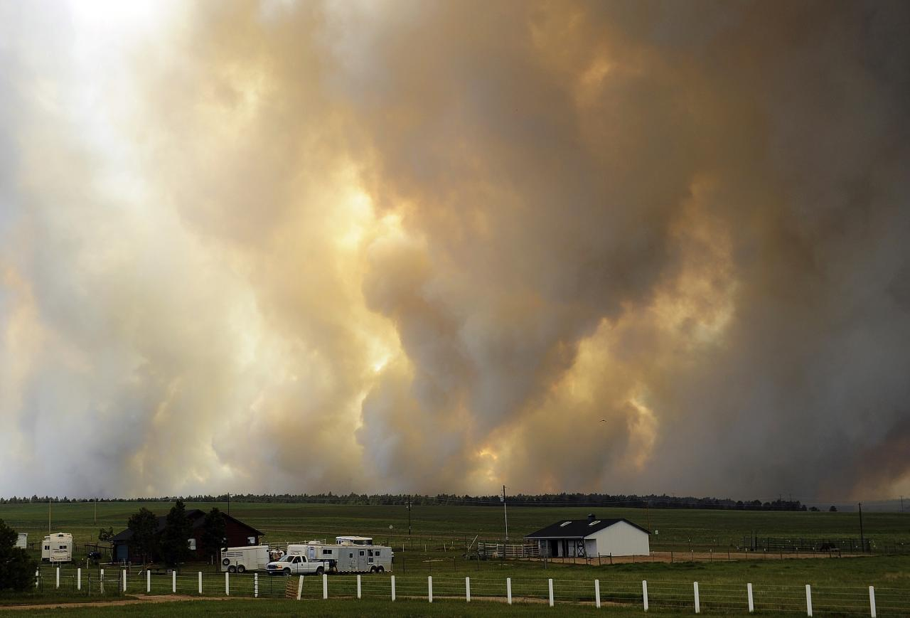 COLORADO SPRINGS, CO - JUNE 12: Smoke rises into the air from the Black Forest Fire June 12, 2013 near Colorado Springs, Colorado. The fire has reportedly burned 80 to 100 homes and has charred at least 8,000 acres. (Photo by Chris Schneider/Getty Images)