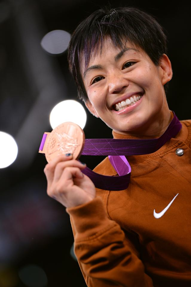 Bronze medalist A Clarissa Kyoko Mei Ling Chun of the United States stands on the podium in the Women's Freestyle 48 kg Wrestling on Day 12 of the London 2012 Olympic Games at ExCeL on August 8, 2012 in London, England. (Photo by Lars Baron/Getty Images)