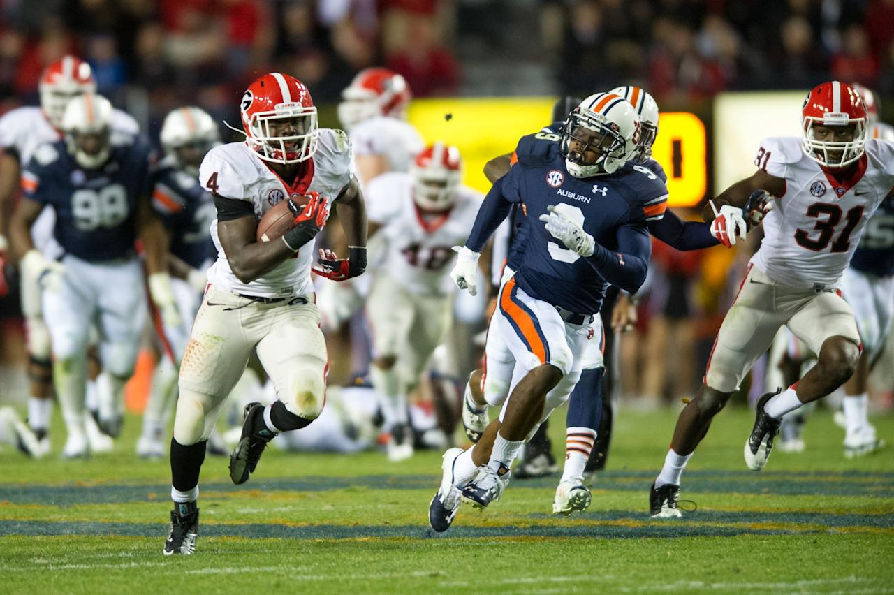 AUBURN, AL - NOVEMBER 10:  Tailback Keith Marshall #4 of the Georgia Bulldogs runs downfield while being chased by defensive back Jermaine Whitehead #9 of the Auburn Tigers on November 10, 2012 at Jordan-Hare Stadium in Auburn, Alabama. Georgia defeated Auburn 38-0 and clinched the SEC East division.  (Photo by Michael Chang/Getty Images)