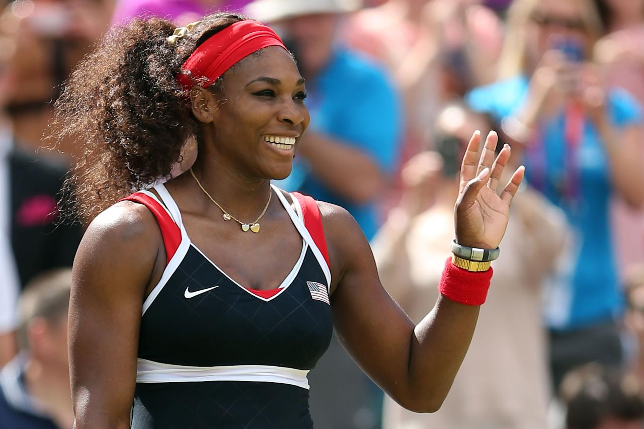 Serena Williams of the United States waves to the crowd after defeating Caroline Wozniacki of Denmark in the Quarterfinals of Women's Singles Tennis on Day 6 of the London 2012 Olympic Games at Wimbledon on August 2, 2012 in London, England.  (Photo by Clive Brunskill/Getty Images)