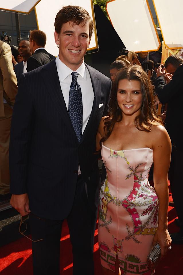 LOS ANGELES, CA - JULY 11:  (-L-R) New York Giants quarterback Eli Manning and Nascar driver Danica Patrick arrive at the 2012 ESPY Awards at Nokia Theatre L.A. Live on July 11, 2012 in Los Angeles, California.  (Photo by Jason Merritt/Getty Images)