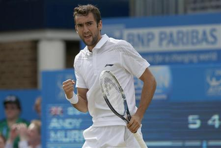 Croatia's Marin Cilic reacts after winning the first set during his men's singles final tennis match against Britain's Andy Murray at the Queen's Club Championships in west London