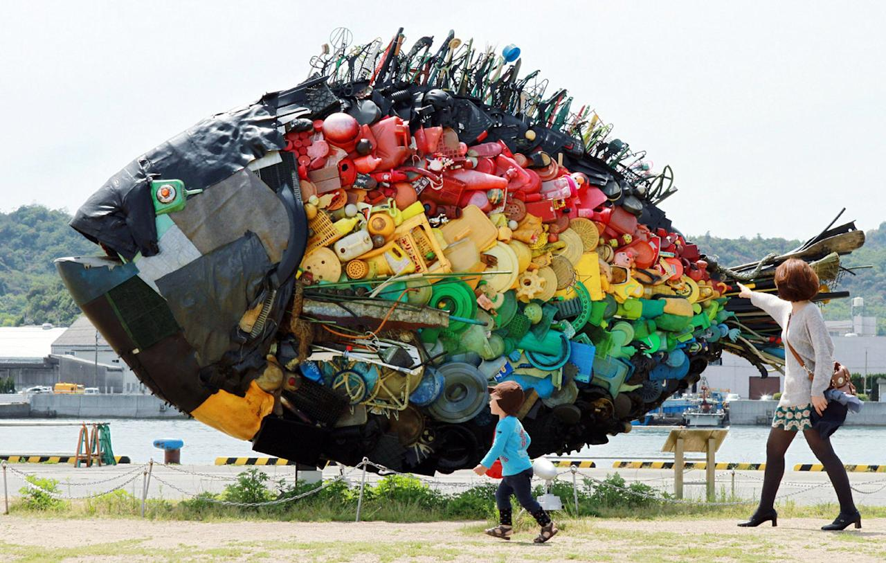 A large sea bream object, made from colourful debris found drifting at sea, such as plastic tanks, toys and wires, and produced by Japanese art group Yodogawa Tecnique, is displayed at the Setouchi Triennale art event at the port of Uno, Okayama prefecture in western Japan on May 19, 2013.  AFP PHOTO / JIJI PRES