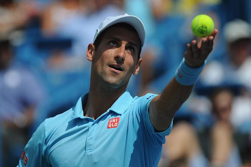Novak Djokovic of Serbia serves against Tommy Robredo of Spain during a match on day 6 of the Western & Southern Open at the Linder Family Tennis Center on August 14, 2014 in Cincinnati, Ohio