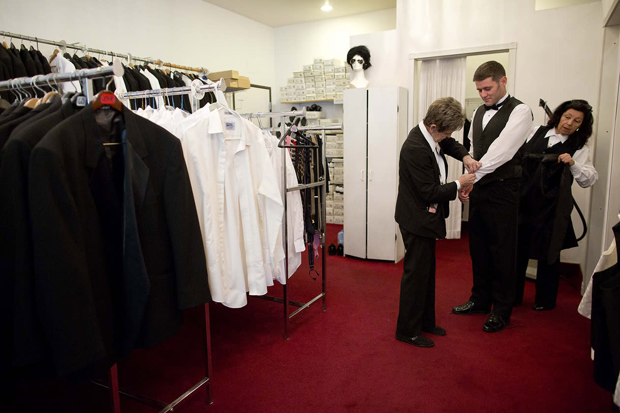 Preparing for his December 12 wedding, Michael Lloyd of Devon, England, tries on a tuxedo with the help of Linda de Marre, left, and Clara Guardado at A Little White Wedding Chapel in Las Vegas.