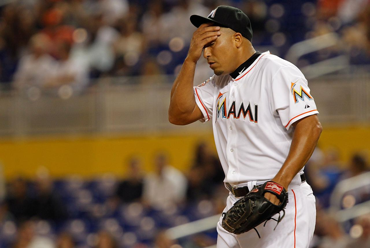 MIAMI, FL - JUNE 26:  Carlos Zambrano #38 of the Miami Marlins wiped his forehead during a game against the St. Louis Cardinals at Marlins Park on June 26, 2012 in Miami, Florida.  (Photo by Mike Ehrmann/Getty Images)