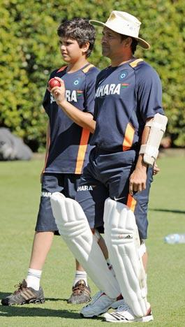 Indian batsman Sachin Tendulkar (R), stands alongside his son Arjun (L), as they watch a nets practice session at the Sydney Cricket Ground (SCG) on January 1, 2012. India plays Australia in the second cricket Test starting at the SCG on January 3. RESTRICTED TO EDITORIAL USE - STRICTLY NO COMMERCIAL USE  AFP PHOTO / Greg WOOD (Photo credit should read GREG WOOD/AFP/Getty Images)