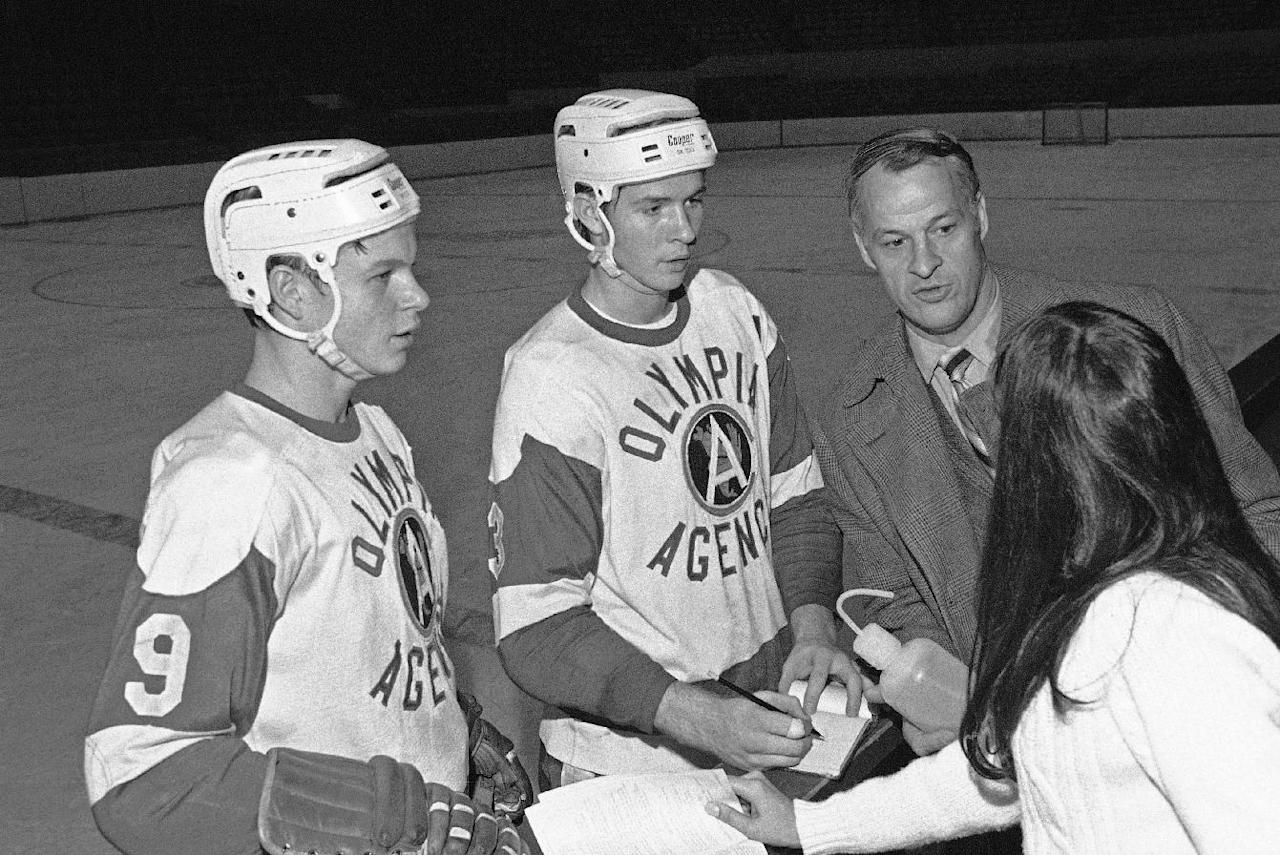 FILE- This January 1971 file photo shows Gordie Howe with his Wing hockey player sons Marty (9) and Mark (3). Mark Howe has earned the right to join his father, Gordie, in the Hockey Hall of Fame. Howe will be inducted Monday Nov. 14, 2011 in Toronto with Ed Belfour, in his first year eligibility, Doug Gilmour and Joe Nieuwendyk. (AP Photo)