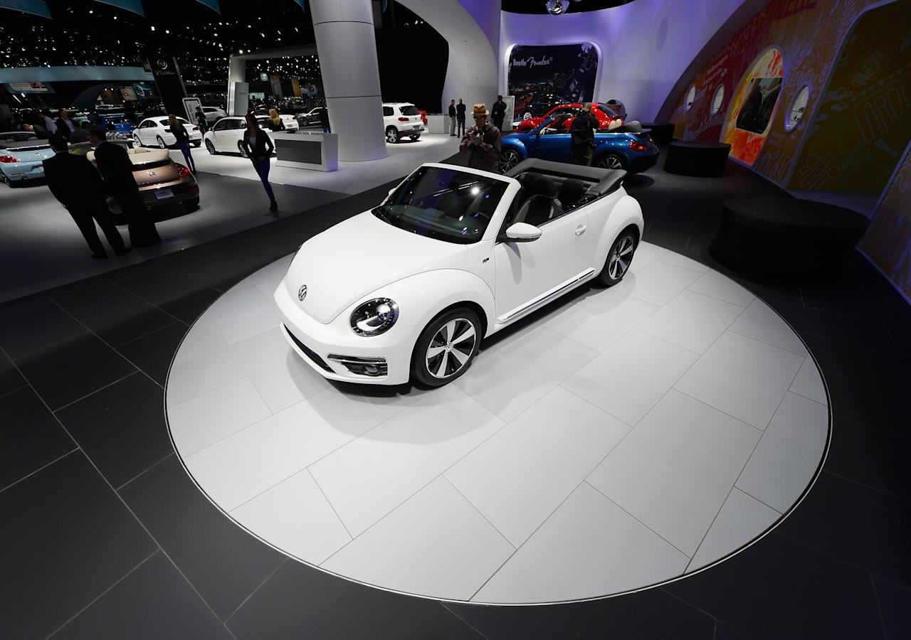 LOS ANGELES, CA - NOVEMBER 29:  New 2013 Volkswagen Beetle convertibles are on display after it was revealed  during the Los Angeles Auto show on November 29, 2012 in Los Angeles, California. The LA Auto Show opens to the public on November 30 and runs through December 9.  (Photo by Kevork Djansezian/Getty Images)