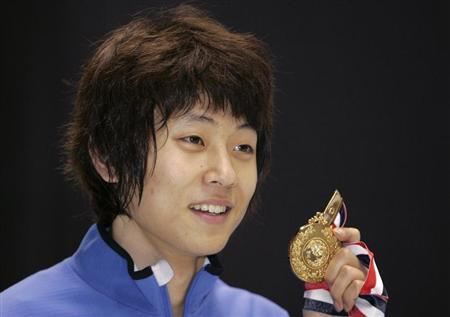 South Korea's Ahn Hyun-Soo poses with his gold medal after winning the men's 1500 metres event of the ISU World Cup Short Track in Kobe, western Japan