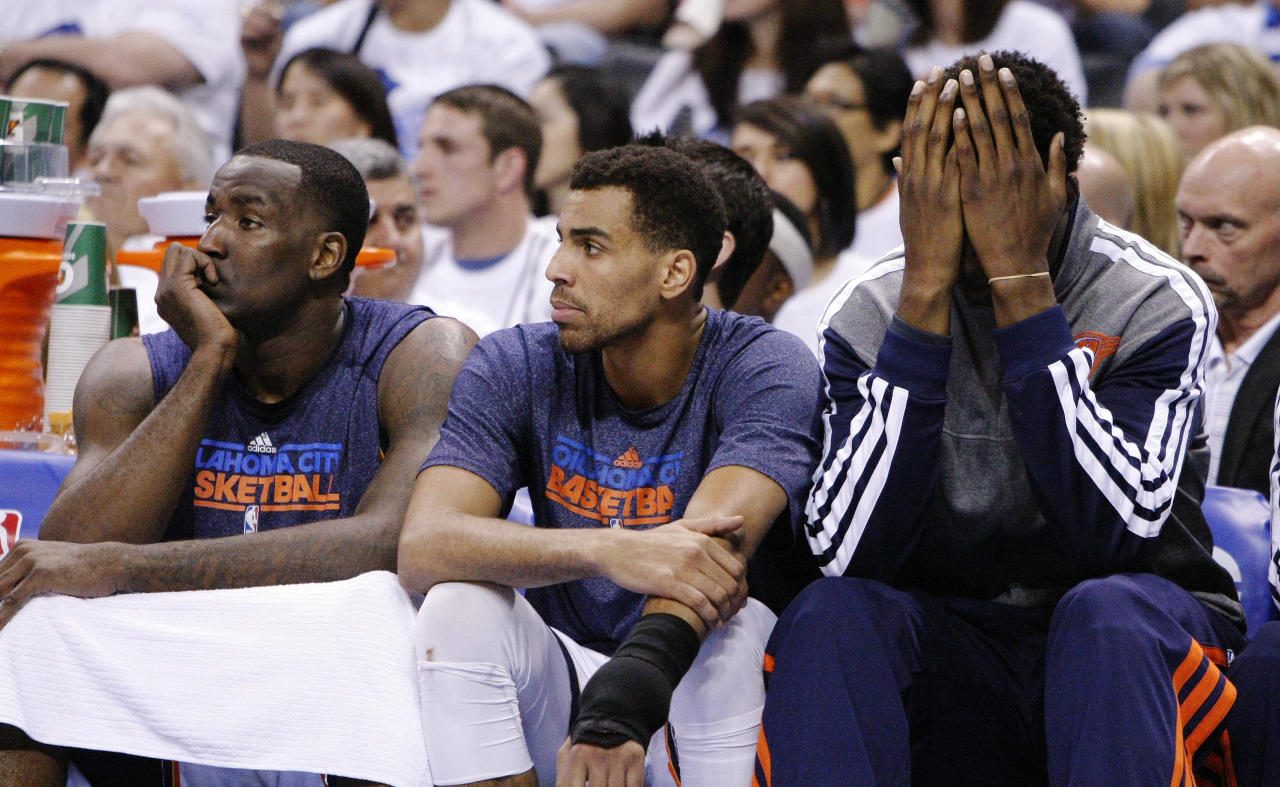 Oklahoma City Thunder's Kendrick Perkins, left, Thabo Sefolosha, center, and Hasheem Thabeet, right, react to a Memphis Grizzlies basket during the first half of Game 5 in an NBA basketball playoffs Western Conference semifinal, in Oklahoma City, Wednesday, May 15, 2013. (AP Photo/Alonzo Adams)