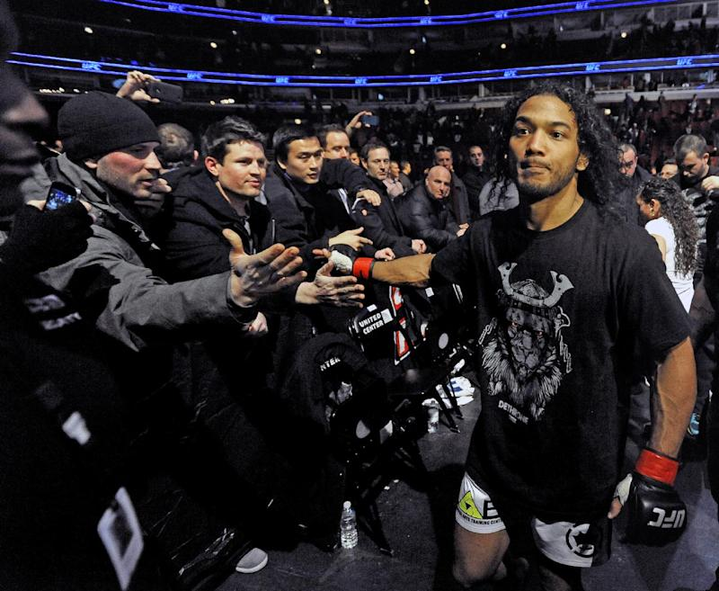 Benson Henderson celebrates with fans after defeating Josh Thomson during the main event of the UFC mixed martial arts match in Chicago, Saturday, Jan., 25, 2014