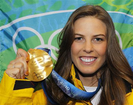 Gold medallist Torah Bright poses with her medal during the medal ceremony for the women's halfpipe at the Vancouver 2010 Winter Olympics in this file photo