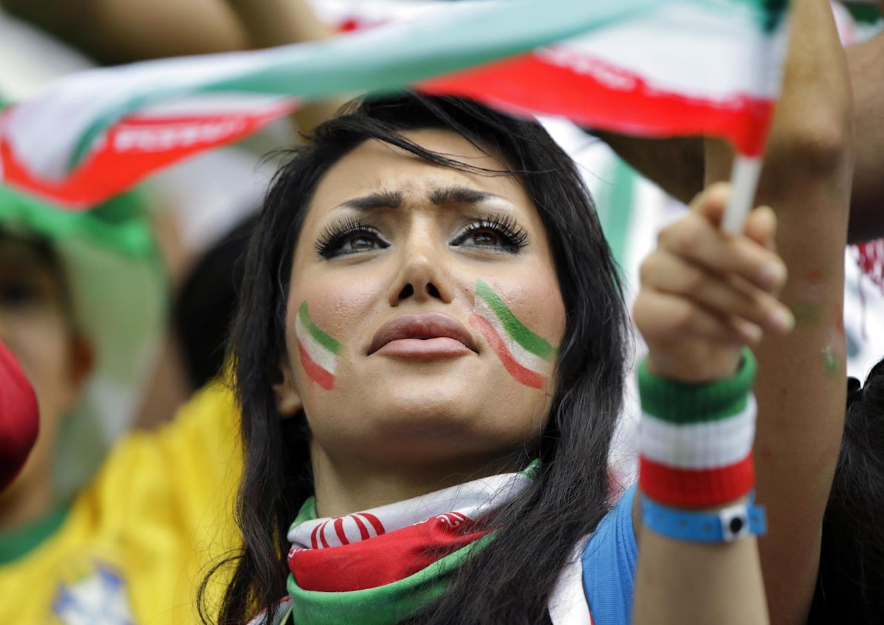 An Iranian fan shows her support before the start of the group F World Cup soccer match between Bosnia and Iran at the Arena Fonte Nova in Salvador, Brazil, Wednesday, June 25, 2014. (AP Photo/Sergei Grits)