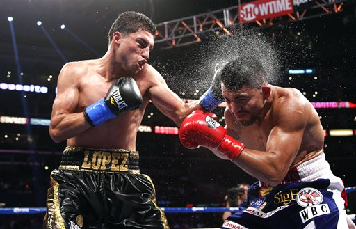 Josesito Lopez (left) upset Victor Ortiz after being named as a replacement opponent. (AP)