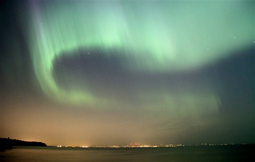 The northern lights fill the sky over the south shore of Lake Superior east of Superior, Wis. above Duluth, Minn., early Sunday, July 15, 2012. A solar storm sparked the spectacular northern lights display in the skies over the Upper Midwest. (AP Photo/The Duluth News-Tribune, Andrew Krueger)