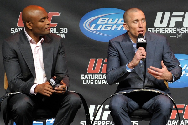Anderson Silva and Georges St-Pierre talk to media during a press conference Thursday. (Getty)