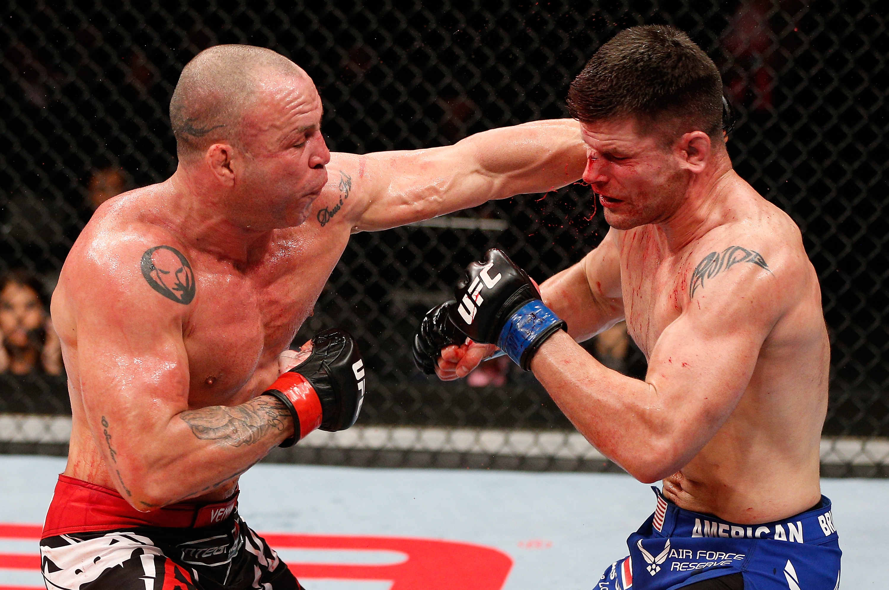 Wanderlei Silva and Brian Stann trade punches during their bout. (Getty)