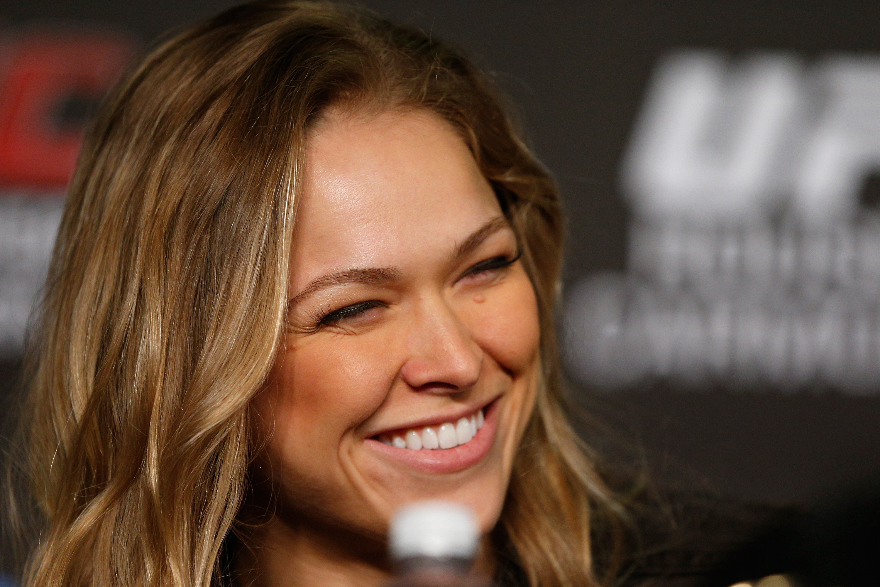 Ronda Rousey smiles during a press conference. (Getty)