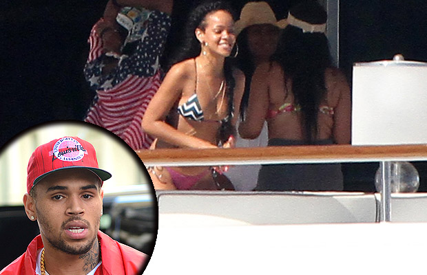 Rihanna told Oprah she met up with Chris Brown aboard a yacht in St. Tropez (Splash News)