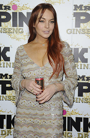 Lohan doing her other job: promoting an energy drink. (Splash News)