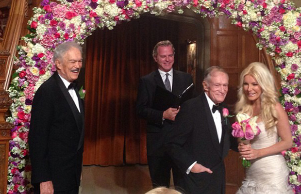 Mr. and Mrs. Hugh Hefner at the altar. (Instagram)