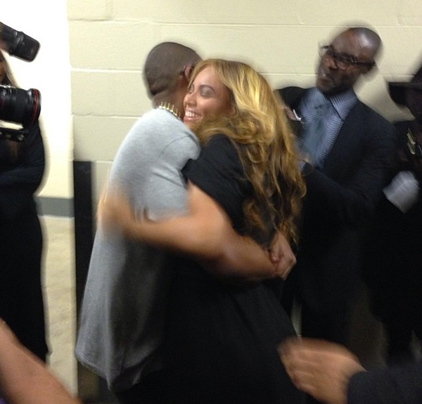 Jay-Z hugs Beyonce after her performance. (Twitter)
